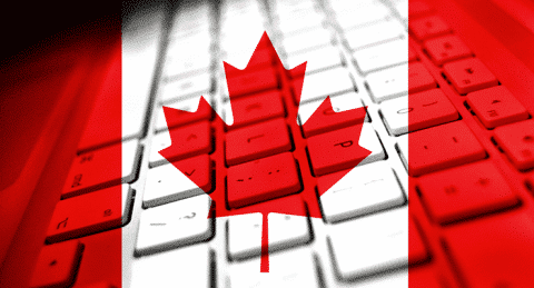 Canadian flag over keyboard