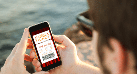 Person booking ticket on mobile phone