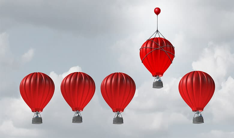 Five red hot air balloons